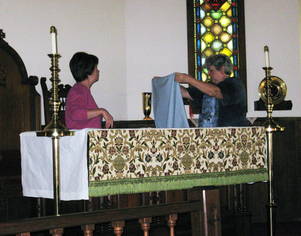 Pam and Leslie Prepare Altar for Service